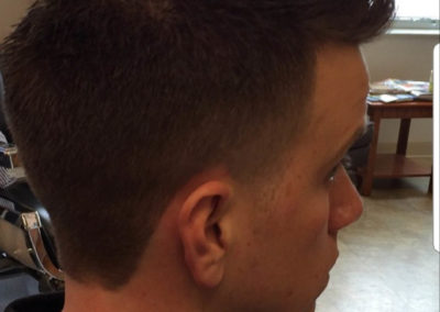 Mens Haircuts & Barber Services - A man looking at the camera - Temple Fade
